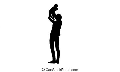 Silhouette Young mama playing with baby by rising him up. -...