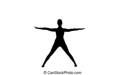 Silhouette Young woman in forward bending asana yoga pose.