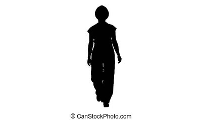 Silhouette Young woman in yellow hardhat walking. - Full...