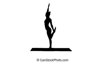 Silhouette Young yogi attractive woman practicing yoga...