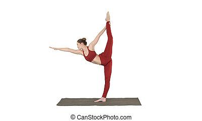medium shot yoga teacher practising pose dandayamana