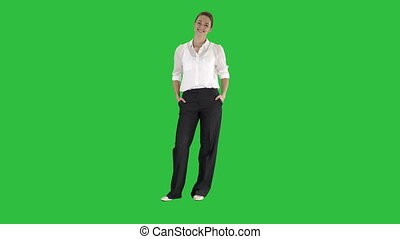 Smiling Female Business Leader Standing And Smiling To Camera on a Green Screen, Chroma Key.