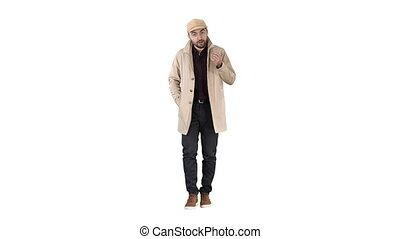 Talking young man in trench coat confidently talking to camera Just move forward on white background.