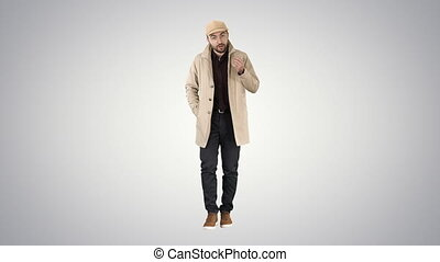 Talking young man in trench coat confidently talking to camera Just move forward on gradient background.