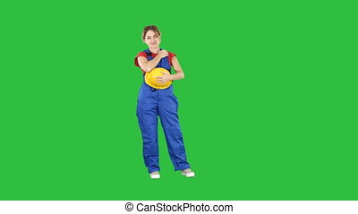 The young woman wear red t-shirt ,with yellow safety helmet ,engineer laughing on a Green Screen, Chroma Key.