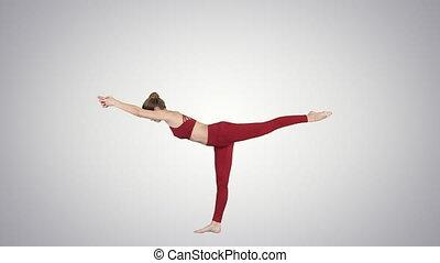 Tuladandasana or Balancing Stick Pose is an advanced yoga posture made by beautiful yogi woman on gradient background.