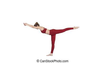 Tuladandasana or Balancing Stick Pose is an advanced yoga posture made by beautiful yogi woman on white background.