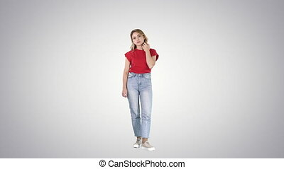 Unhappy and thoughtful young woman in casual on gradient...