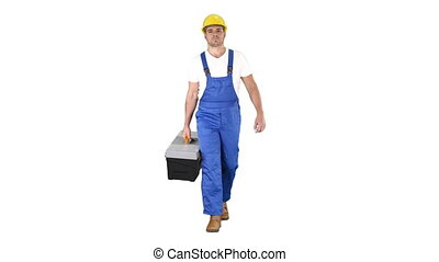 Full length shot. Walking construction worker with toolbox on white background. Professional shot in 4K resolution. 014. You can use it e.g. in your commercial video, business, presentation, broadcast