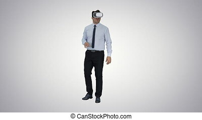 Astonished young businessman wearing VR glasses Concept of...