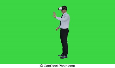 Businessman in virtual reality headset walking in virtual...