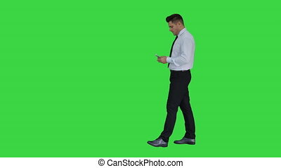 Businessman is counting money on a Green Screen, Chroma Key.