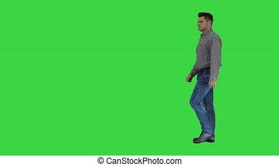 Casual man walking on a Green Screen, Chroma Key.