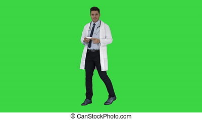 Doctor presenting vitamins and talking about them to camera on a Green Screen, Chroma Key.