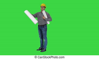 Engineer checking plan on construction site on a Green Screen, Chroma Key.