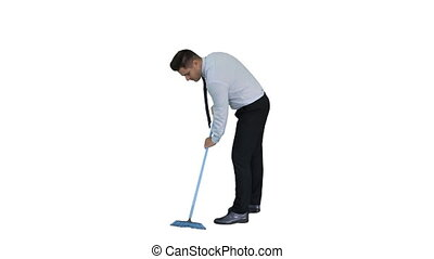 Man in official clother sweeping the floor on white...