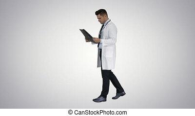 Neurosurgeon observing MRI scan, examining progress of...