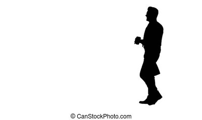 Silhouette Businessman walking with take away coffee and...