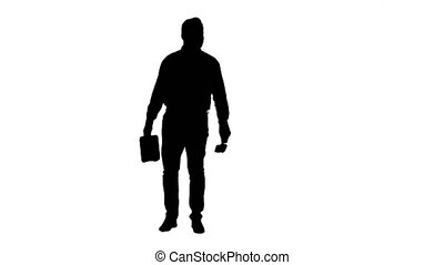 Silhouette Casual man with brush and some liquid looking...