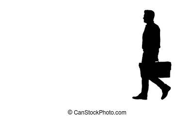 Silhouette Professional repairman concept. Handyman walking...