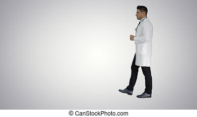 Walking male doctor passing by on gradient background. -...
