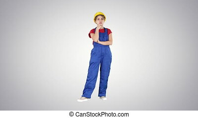 Woman in construction uniform listening to instructions on...
