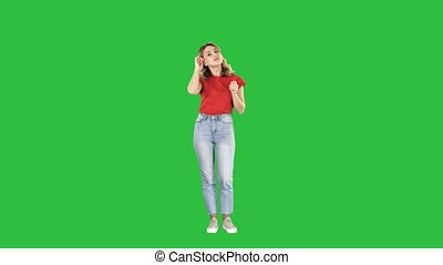 Woman in front of a mirror preening on a Green Screen, Chroma Key.