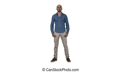 Full length shot. Young arabic man smiling on white background. Professional shot in 4K resolution. 011. You can use it e.g. in your commercial video, business, presentation, broadcast