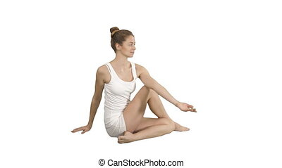 Young beautiful woman doing yoga asana Marichyasana on white background.