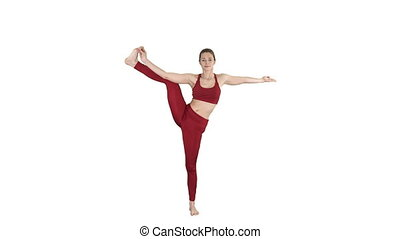 Young woman practicing yoga, standing in Utthita Hasta Padangustasana exercise, Extended Hand to Big Toe pose on white background.