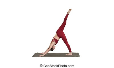 Beautiful young woman wearing red sportswear doing yoga or...