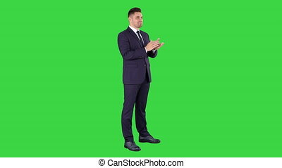 Businesses man applauding on a Green Screen, Chroma Key. -...