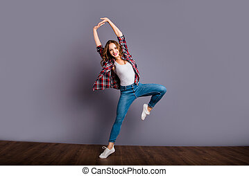 Full length size body view photo of fly high amazing attractive beautiful she her lady modern dance training zumba flexible wearing casual jeans denim checkered plaid shirt on grey background