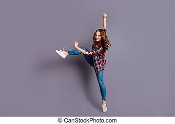 Full length size body view photo of fly high attractive beautiful she her lady modern dance queen very flexible wearing casual jeans denim checkered plaid shirt on grey background