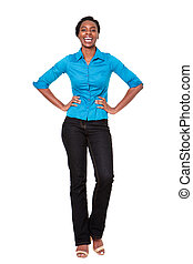 Full length smiling african american woman standing on isolated white background