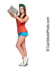 Full length sporty female with digital tablet