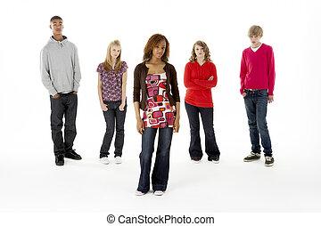 Full Length Studio Portrait Of Five Teenage Friends