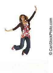 Full Length Studio Portrait Of Jumping Teenage Girl
