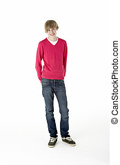 Full Length Studio Portrait Of Teenage Boy