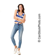 Full length trendy young asian woman smiling with arms crossed against isolated white background