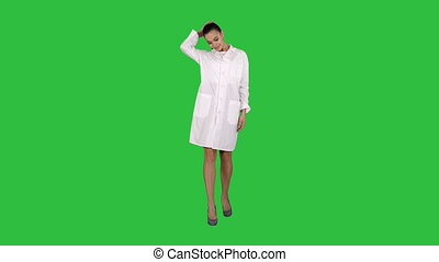 Happy young woman doctor dances on a Green Screen, Chroma...