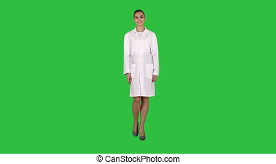 Medical doctor woman going straight on a Green Screen,...