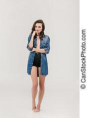 pensive girl in denim shirt