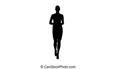 Silhouette Businesswoman walking and talking to the camera...