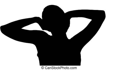 Silhouette Contented happy young woman stretching her arms...