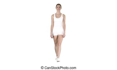 Sporty styles woman walking in white on white background.