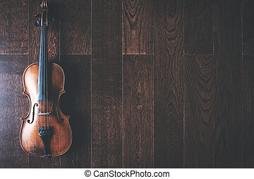 Full length violin on wooden floor