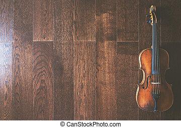 Full length violin on wooden flooring