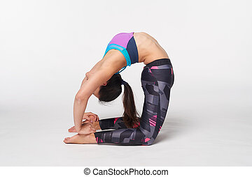 young yogi attractive woman in single pigeon pose loft