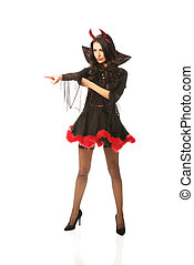 Full length woman wearing devil clothes pointing to the corner